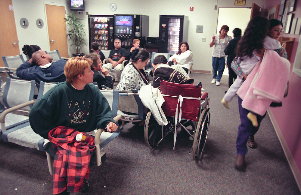 People wait at a crowded emergency room at Riverside County Reginal Medical Center in Moreno Valley, CA east of Los Angeles. Please Contact Me With Licensing Questions or Requests.