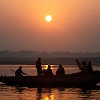 Asia, india, Varanasi. Boat at Sunrise on the holy Ganges River at Varanasi.