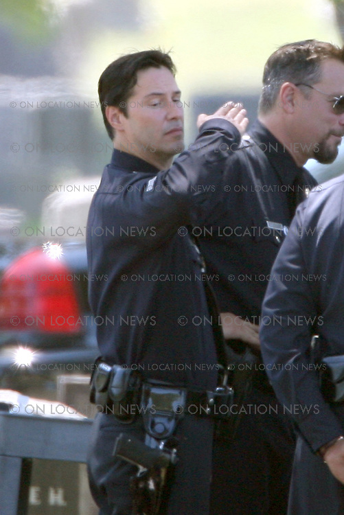 LOS ANGELES, CALIFORNIA - Wednesday July 11th 2007. NON EXCLUSIVE: Actor Keanu Reeves & Oscar winner Forest Whitaker on set of their latest movie 'Street Kings' aka 'The Night Watchman'. Reeves plays a veteran LAPD cop who finds life difficult to navigate after the death of his wife. When evidence implicates him in the execution of a fellow officer, he is forced to go up against the cop culture he's been a part of his entire career, ultimately leading him to question the loyalties of everyone around him. Photograph: Buchan/On Location News. Sales; Eric Ford.1/818-613-3955.info@onlocationnews.com ***FEE MUST BE AGREED PRIOR TO USAGE***