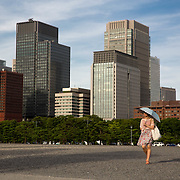 A woman walks on the grounds of the Imperial palace in Tokyo, Japan.