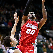 SHOT 2/23/10 9:08:59 PM - New Mexico's A.J. Hardeman goes up for a shot over Colorado State's Dorian Green during the first half of their regular season Mountain West Conference game at Moby Arena in Fort Collins, Co. New Mexico survived a tight game winning 72-66. (Photo by Marc Piscotty / © 2010)