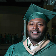 U'Gundi Jacobs pose for a photo after Wilmington University commencement exercise Sunday, May 17, 2015, at Chase Center On The Riverfront in Wilmington Delaware.