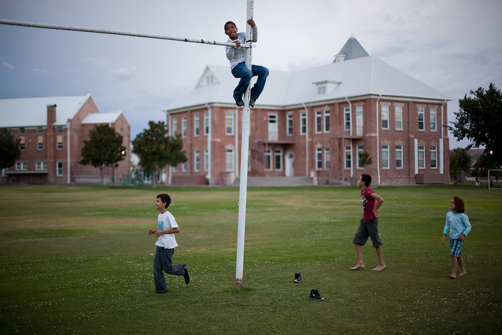 Children play on the school yard in Colonia Juarez, Mexico in July 2011. United States Presidential candidate Mitt Romney's family migrated to Mexico over 100 years ago after being granted asylum from Mexican President Porfirio Diaz after they had been pursued by the U.S. authorities for polygamy...(Romney is currently running for the Republican nomination.)