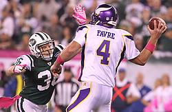 Oct 11, 2010; East Rutherford, NJ, USA; New York Jets safety Jim Leonhard (36) pressures Minnesota Vikings quarterback Brett Favre (4) during the first half at the New Meadowlands Stadium.