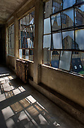 In 1990, the Ellis Island Immigration Museum opened on the island's north side.  However, some thirty buildings on the south side remain un-restored.  High Definition Range (HDR) image.