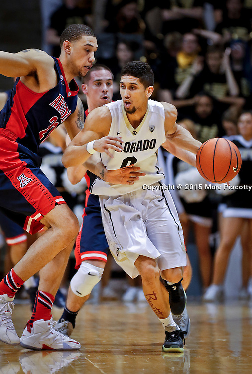SHOT 2/26/15 8:51:32 PM - Colorado's Askia Booker #0 looks to drive past the defense of Arizona's Brandon Ashley #21 during their regular season Pac-12 basketball game at the Coors Events Center in Boulder, Co. Arizona won the game 82-54.<br /> (Photo by Marc Piscotty / &copy; 2015)