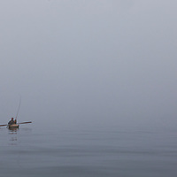 WA09191-00...WASHINGTON - Phil Russell kayak fishing on a foggy morning in the Strait of Juan De Fuca. (MR# R8)