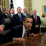 President Barack Obama signs executive orders closing Guantanamo Bay (GITMO) and laying out torture guidelines Thursday, January 22, 2009.  Next to him is VP Biden and behind him are retired military officers...Photo by Khue Bui