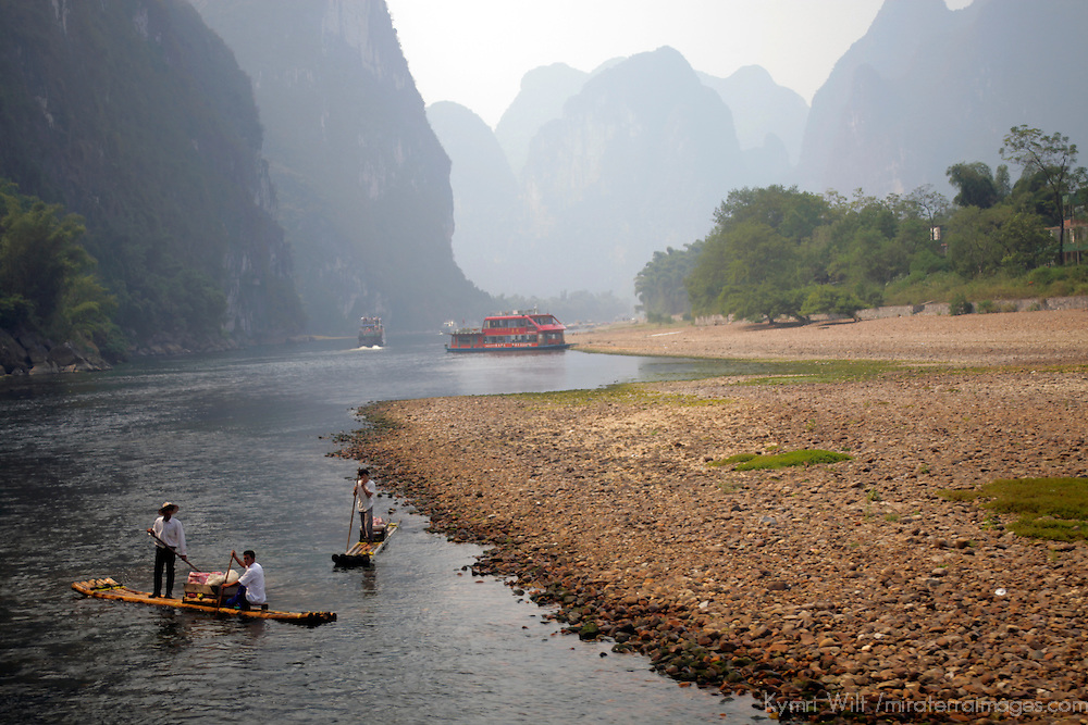 Asia, China, Guilin. Bamboo rafts serve as river transportation in the shallow waters of the Li River.