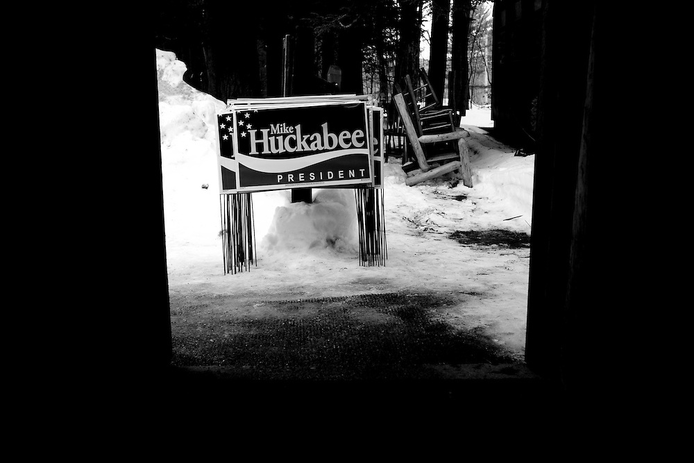 Campaign signs for former Arkansas governor Mike Huckabee sit on the ground in Milford, N.H., on Monday, Jan. 7, 2008.