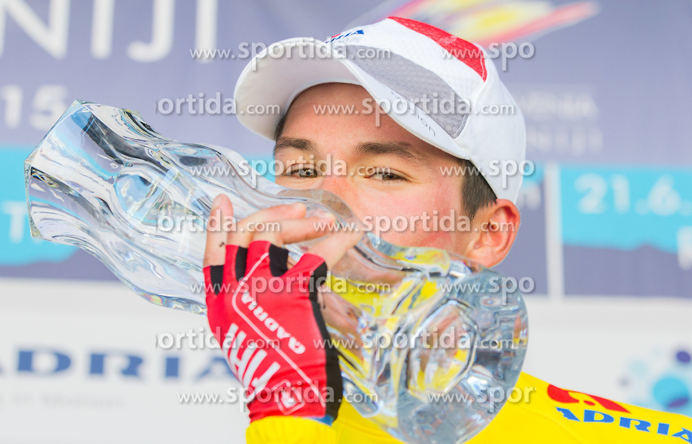 ROGLIC Primoz (Slovenia) of Adria Mobil, overall winner in yellow jersey celebrate during trophy ceremony after the Stage 4 of 22nd Tour of Slovenia 2015 from Rogaska Slatina to Novo mesto (165,5 km) cycling race  on June 21, 2015 in Slovenia. Photo by Vid Ponikvar / Sportida