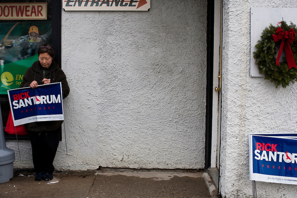 A woman waits for Republican presidential candidate Rick Santorum to arrive at Pelletier's Sports Shop on Friday, January 6, 2012 in Jaffrey, NH.