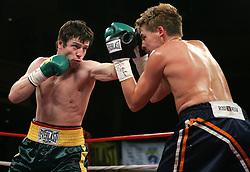 """Irish"" John Duddy (l) and Byron Mackie (r) trade punches during their 10 round bout at Hammerstein Ballroom in NYC.  Duddy won the bout via 4th round KO to remain undefeated at 13-0, 12KO's."
