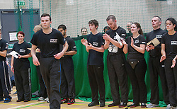 P1 students receives his certificate from Franklyn Hartkamp at the Institute Of Krav Maga Scotland grading today at Stirling.<br /> &copy;Michael Schofield.