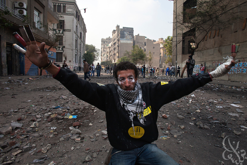 An Egyptian protester wears spent security force shotgun shells on his fingers as he taunts nearby security forces during continuing clashes November 22, 2011 near Tahrir square in central Cairo, Egypt. Thousands of protesters demanding the military cede power to a civilian government authority clashed with Egyptian security forces for a fourth straight day in Cairo, with hundreds injured and at least 29 protestors killed under intense barrages of tear gas, buckshot and rubber bullets.  (Photo by Scott Nelson)