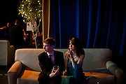 """Jason Green, left, and Anna Hoover relax in the """"Special Guests"""" area at the Inaugural Ball, January 21, 2013 in Washington, D.C."""