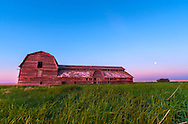 The old barn near home in southern Alberta at sunset, June 11, 2014, with the Moon one day before full rising in the southeast. The blue shadow of the Earth and pink Belt of Venus are visible below the Moon on the horizon. This was shot as part of a time-lapse dolly sequence using  the Canon 60Da and 10-22mm lens.