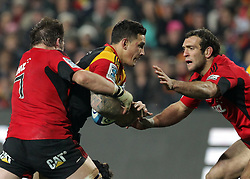Chiefs' Sonny Bill Williams is tackled by Crusaders' Richie McCaw and Adam Whitelock in a Super Rugby match, Waikato Stadium, Hamilton, New Zealand, Friday, July 06, 2012.  Credit:SNPA / David Rowland