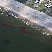 Gulf of Mexico, Louisiana (USA). May 21th, 2010. .Aerial view of the oil leaked from the Deepwater Horizon wellhead  reaching Grand Isle. The BP leased oil platform exploded on April 20 and sank after burning. Photo © Daniel Beltra/Greenpeace
