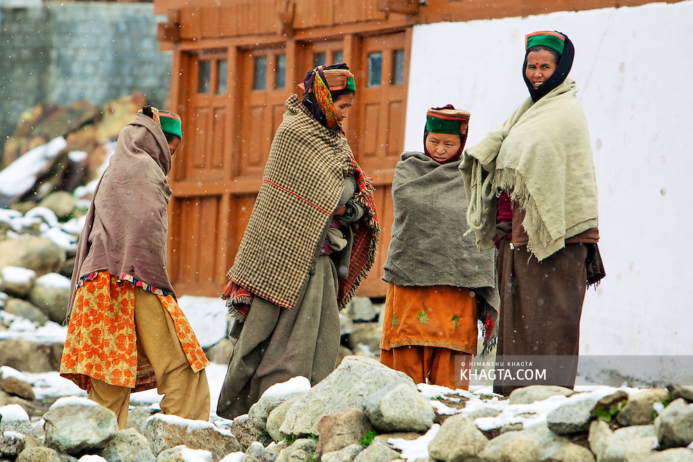 People of village Chitkul, Sangla, covered with warm clothes going back to their houses when it started to snow in the month of April.