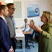 U.S. Democratic presidential nominee Hillary Clinton talks to Jeremy Priest (L) and Mark Johnson, co-founders of the Knotty Tie company in Denver August 3, 2016. REUTERS/Rick Wilking