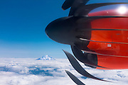Mt Rainier rises above a blanket of clouds, seen from the window of an Alaska Airlines turboprop plane. (The strange stroboscopic propeller effect is caused by the electronic shutter and fast shutter speed.)