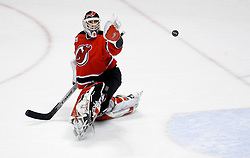 April 26, 2007; East Rutherford, NJ, USA; New Jersey Devils goalie Martin Brodeur (30) watches the puck tip off his glove during the first period at Continental Airlines Arena in East Rutherford, NJ.
