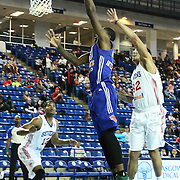 Westchester Knicks Forward Thanasis Antetokounmpo (43) drives towards the basket as Delaware 87ers Forward Drew Gordon (32) defends in the first half of a NBA D-league regular season basketball game between the Delaware 87ers and the Westchester Knicks (New York Knicks) Sunday, Dec. 28, 2014 at The Bob Carpenter Sports Convocation Center in Newark, DEL