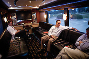 GOP presidential candidate Gov. Mitt Romney talks with strategist Russ Schriefer on his campaign bus after  a campaign rally at Carter Machinery Company in Salem, Virginia, June 26, 2012.