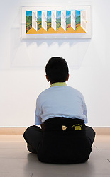 Christies, St James, London, March 4th 2016. A boy from Charlton Manor Primary School admires Patrick Hughes' &quot;Shutters&quot;, a hand painted with lithography piece created in 2003, at the preview for the It&rsquo;s Our World charity auction at Christie's. Over 40 leading artists including David Hockney, Sir Antony Gormley, David Nash, Sir Peter Blake, Yinka Shonibare, Sir Quentin Blake, Emily Young and Maggi Hambling have committed artworks to the It&rsquo;s Our World Auction in support of The Big Draw and Jupiter Artland Foundation, to be sold at Christie&rsquo;s London on 10 March 2016.<br />  ///FOR LICENCING CONTACT: paul@pauldaveycreative.co.uk TEL:+44 (0) 7966 016 296 or +44 (0) 20 8969 6875. &copy;2015 Paul R Davey. All rights reserved.