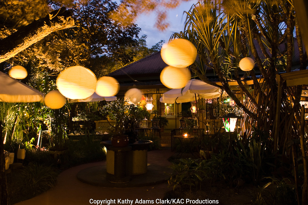 Corteza amarilla hotel, in san Jose, costa rica, courtyard and dining area at night.