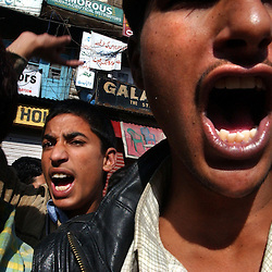 "Kashmiri youth scream ""We want freedom"" during a protest in the streets of Srinagar on September 24. Few people braved anti-poll violence in Kashmir's main city to vote in a state election after an early morning gun battle between Indian Border Security Forces and suspected Muslim militants."