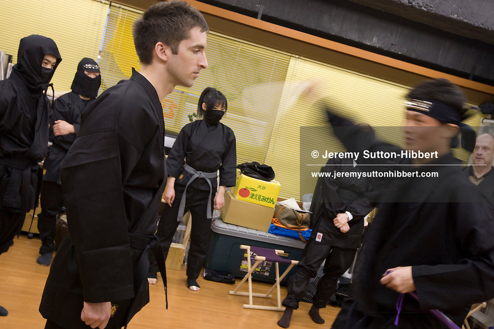 Henry Rimmer (foreground, left of pic), journalist for UK magazine 'FHM', undergoes training with modern day ninjas, from the Keizan group, in the Keizankai Dojo, in Ikebukuro district of Tokyo, Japan, Wednesday, March 25, 2009.