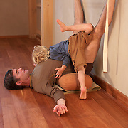 Tias Little and son, Eno, play around in the yoga studio