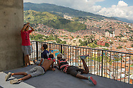 2015/11/20- Medellín, Colombia: A group of boys hangout in Barrio Las Independencias in Comuna 13, Medellín. The Comuna 13 was once one of the most violent of Medellín. Nowadays many tourists come to visit to see its famous street art and the iconic electric stairscases that facilitate the mobility of the residents up and down the hill. Life in Medellín is changing quickly. Once consider the murder capital of the world is now being revitalized by enormous urbanism projects. (Eduardo Leal)