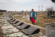 Vuyiswa Moalosi, 58, pictured beside the graves of the 69 people killed in the Sharpeville massacre of March 1960, in Sharpeville, South Africa. The massacre led to anti-apartheid organisations like the ANC taking up armed resistance. President Nelson Mandela chose Sharpeville for the signing into law of the Constitution of South Africa on 10 December 1996.