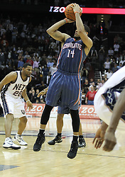 Apr 11; Newark, NJ, USA; Charlotte Bobcats point guard D.J. Augustin (14) hits the game-winning shot during the second half at the Prudential Center. The Bobcats defeated the Nets 105-103.