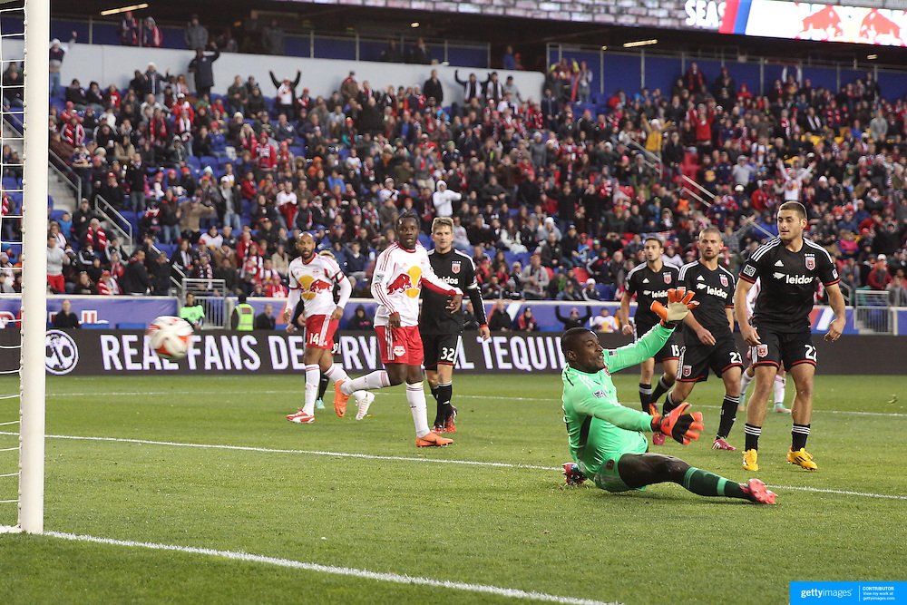Bradley Wright-Phillips, (out of frame), New York Red Bulls, scores his sides first goal past goalkeeper Bill Hamid, DC United, during the New York Red Bulls V DC United, MLS Cup Playoffs, Eastern Conference Semifinals first leg at Red Bull Arena, Harrison, New Jersey. USA. 2nd November 2014. Photo Tim Clayton