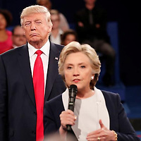 "Republican U.S. presidential nominee Donald Trump listens as Democratic nominee Hillary Clinton answers a question from the audience during their presidential town hall debate at Washington University in St. Louis, Missouri, U.S., October 9, 2016. REUTERS/Rick Wilking /File Photo                  FROM THE FILES PACKAGE ""THE CANDIDATES"" - SEARCH CANDIDATES FILES FOR ALL 90 IMAGES - RTX2SFHW"