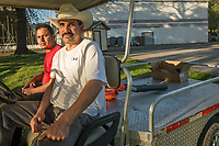 Juan Garcia and Luis Morales work to prepare for Saturday's Monster Truck Show at the Calistoga Speedway.