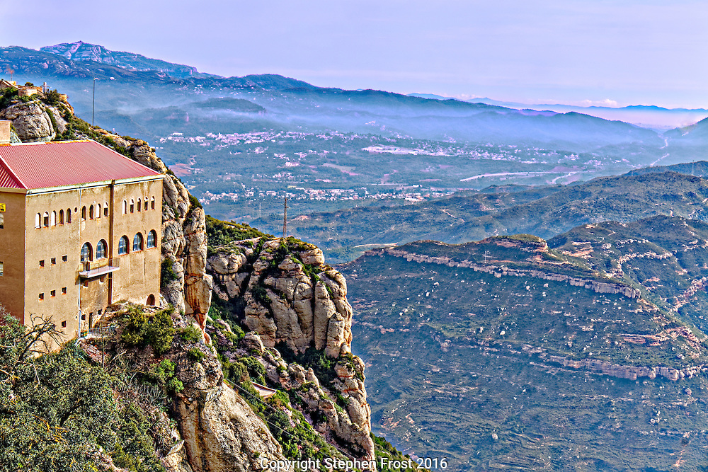 A view over the misty valley from the mountain-top monastery at Montserrat in Catalonia, Spain.