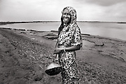 Food is unsecured around coastline area. Women often spend the day in search for food in the river. Image © Mohammad Rakibul Hasan/Falcon Photo Agency