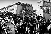 &quot;NOTE&quot; small digital files !<br /> On Nov. 11 2004, Yassir Arafat died at a french military hospital. The day after, world leaders honored him at a ceromony in Cairo and afterwards his casket was brought by helicopter to his compound in Ramallah &ndash; The compound in which Israel confined him for years. Amid houndreds of thousands of  chaotic and highly emotional mourners Yasser Arafat was buried. He died at the age of 75. <br /> Arafat's compound after thousands of mourners crashed the gates.