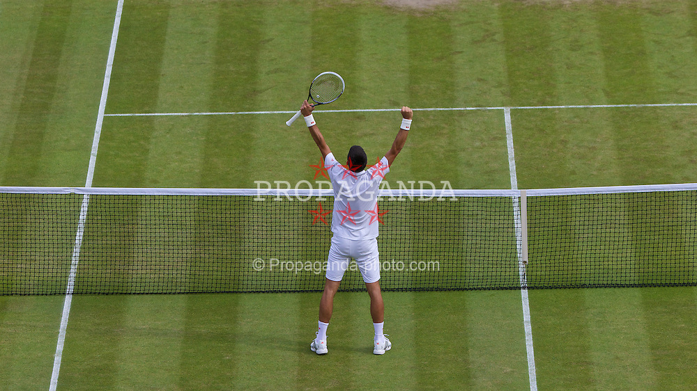 LONDON, ENGLAND - Wednesday, July 2, 2014: Novak Djokovic (SRB) celebrates after winning the Gentlemen's Singles Quarter-Final match on day nine of the Wimbledon Lawn Tennis Championships at the All England Lawn Tennis and Croquet Club. (Pic by David Rawcliffe/Propaganda)
