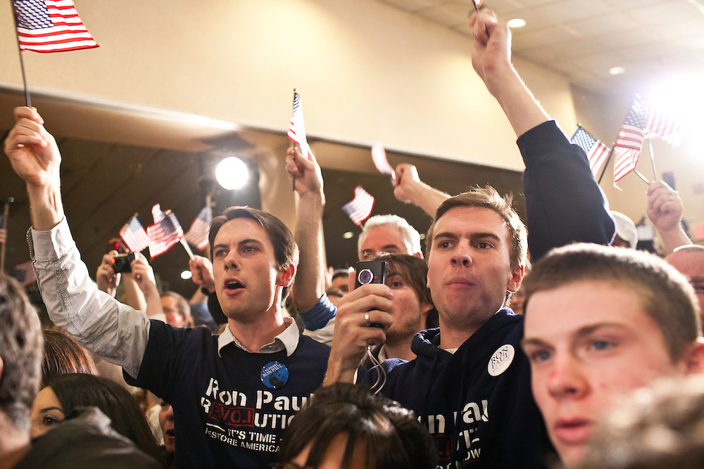 Supporters of Republican presidential candidate Ron Paul cheer at his primary night rally at the Executive Court banquet facility on Tuesday, January 10, 2012 in Manchester, NH. Brendan Hoffman for the New York Times