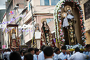 Religious images are taken in procession Tuesday of Holy Week through the streets of Ayacucho, Peru.