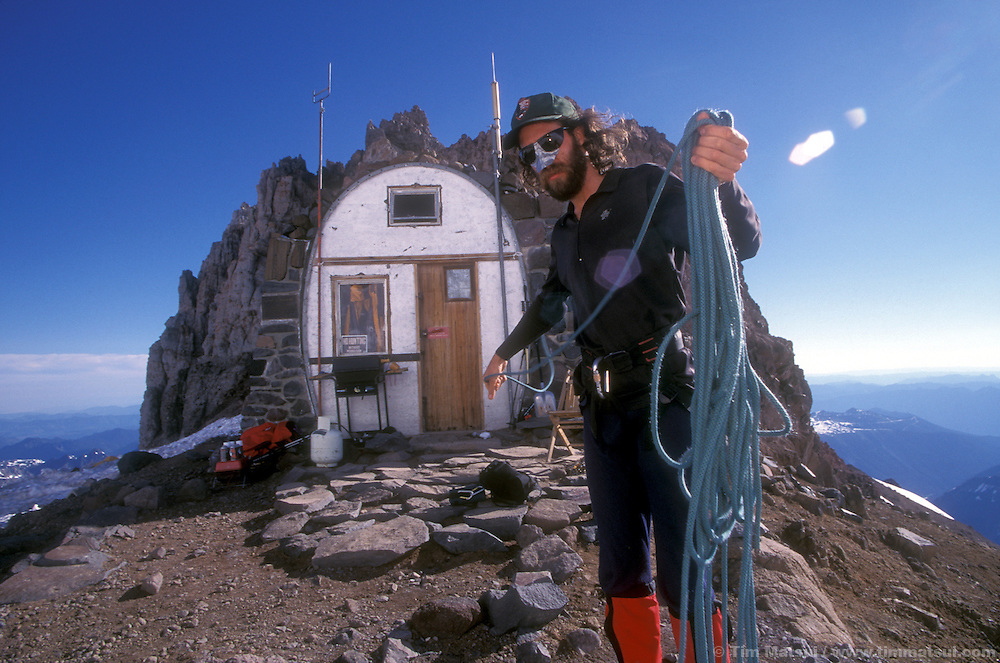 Climbing Ranger David Gottlieb coils a rope at Camp Schurman in preparation for an afternoon climb and patrol of the Emmons Glacier on Mt. Rainier. The Emmons is the second most popular climbing route on Mt. Rainier and is often used as a descent route for harder climbs like Liberty Ridge and Ptarmigan Ridge.