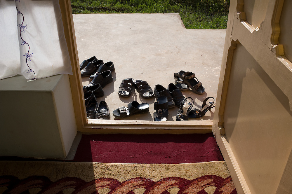 Shoes are left outside the door when people come in to attend a meeting with MP. Ms. Fawzia Koofi. Faizabad, Badakshan, 2012