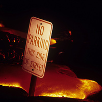 USA, Hawaii, Volcanoes National Park,  Lava covers No Parking sign along Chain of Craters Road during Kilauea eruption