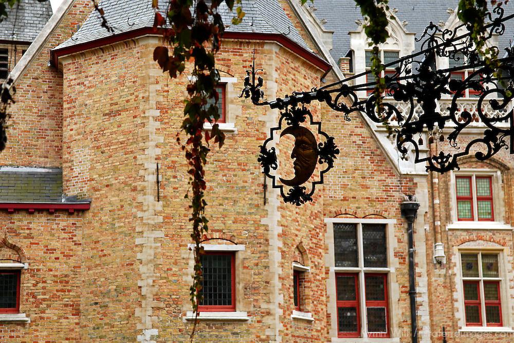 Europe, Belgium, Brugges. Iron sign in arch in Brugges.